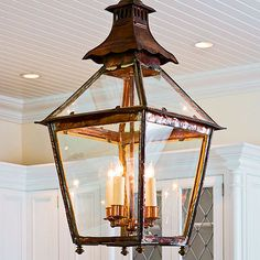 Giving the island focal-point status are a pair of 17th-century antique English lanterns. Not just pretty faces, the lanterns were electrified and provide task and mood lighting.
