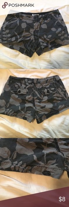 "Old Navy Black and Gray shorts Old navy black and gray floral print shorts. 3"" inseam. Small nic in fabric on the back, bottom left leg. (Last picture) not noticeable when wearing Old Navy Shorts"