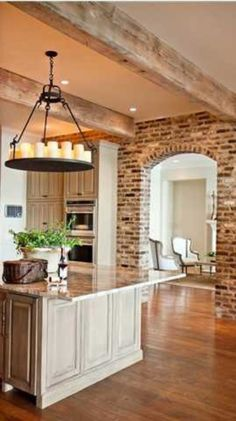 white-washed wood, granite, pillar candle chandelier, exposed brick, wood beams...