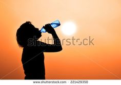 Silhouette of young woman drinking water  ( thirsty, hot feeling  need to drink cold water)