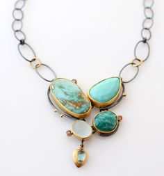 Turquoise Beach Pebble necklace | Sydney Lynch  ||    turquoise, amazonite, aquamarine, apatite, brown diamonds, oxidized silver, 18k & 22k gold. Pendant section is 1 1/2 inches long on an 18 inch chain. $3,100.