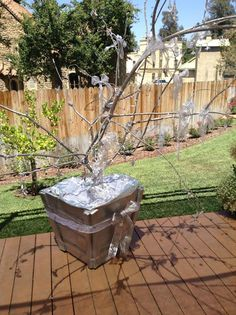 Garden designer @edenmakersblog turns a large fallen branch into a glistening Christmas tree! #christmaskeepsake #christmas #christmastree #DIY #branch #homeandfamily #homeandfamilytv