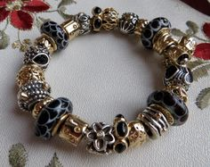 Pandora Jewelry OFF!>> Fully completed black and gold Pandora bracelet Pandora Bracelet Charms, Pandora Jewelry, Charm Bracelets, Black Bracelets, Fashion Bracelets, Pandora Gold, Silver Charms, Jewelery, Creations