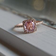 drool-worthy rose gold and peach-lavender-champagne engagement ring.