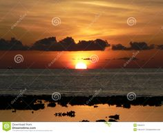 Photo about Going , going, gone - the sun sets on the Indian Ocean in the Maldives. Image of clipart, concept, boat - 5384015