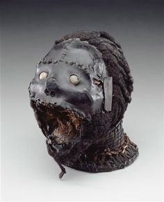 Late 19th-early 20th century, African art from Nigeria. The mask is built on a real human skull, hung with antelope skin, and covered with human hair on the skull and chin. Pretty different.
