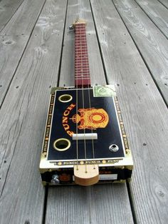 """Cigar Box Guitar Someone made an electric one for the Havana house in board man! I don't """"need"""" one but I had so much fun playing it. (: I'd like to make one with hekp."""