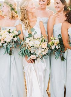 Bridesmaids in Dusty Blue Dresses with Organic Bouquets | Danielle Poff Photography | http://heyweddinglady.com/natural-elegance-southern-california-vineyard/