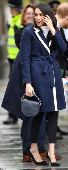 Meghan Markle arrived in Birmingham this morning wearing a $298 navy Italian stadium-cloth wool coat by J Crew teamed with an unstructured £168 jumper from All Saints
