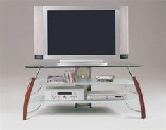 Martini cherry finish wood chrome finish metal tv stand entertainment center unit with storage shelves. Features a cherry finish wood accent and a chrome metal frame with glass top and shelves. Measures x x H. Some assembly required.
