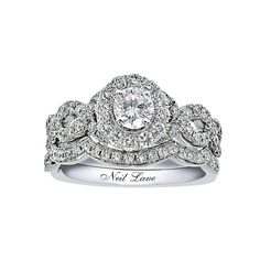 Brides.com: Engagement Rings with Pavé Settings. Style 940201900, Neil Lane Bridal 14K white gold 1-1/6 carat t.w. round diamond bridal set, $3,499.99, Kay Jewelers  See more Kay Jewelers engagement rings.