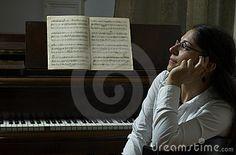 Pensive Piano Teacher Portrait by Pavalache Stelian, via Dreamstime