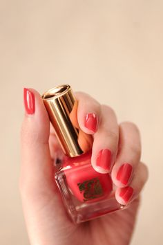 Hot Coral Nail Lacquer. Rich color and long-lasting.