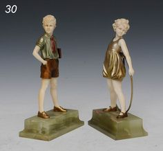 """FERDINAND PREISS (PAIR) Bronze and Ivory figures of Girl with Hoop and Boy with Book, larger 8 3/8"""" overall, circa 1925 sold $13,000 www.fairfieldauction.com"""