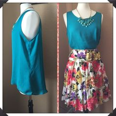 Teal hi-low tank with matching statement necklace NWT teal hi-low tank top with matching statement necklace. Silky polyester. Cute alone or tucked in for layering. Perfect for spring!  Skirt also available. See separate listing. HeartSoul Tops Tank Tops