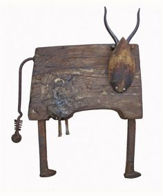 Wood cow from old stable floor boards and recycled metal tools.