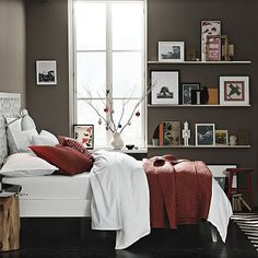 Love the darker brown on the walls with lighter toned furniture and pops of color!