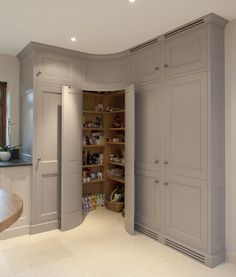 Corner pantry with convex curved doors - grey kitchen cabinets - Bespoke Interiors. Not so much the curved idea but a corner pantry. Kitchen Corner Cupboard, Pantry Cupboard, Kitchen Pantry Design, Kitchen Cabinet Storage, Grey Kitchen Cabinets, Pantry Doors, Corner Armoire, Kitchen Organization, Kitchen Ideas
