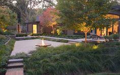 plantes vivaces, graminées et arbres entourent la terrasse