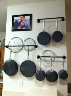 Hang pots and pans on towel racks to create more cabinet space!