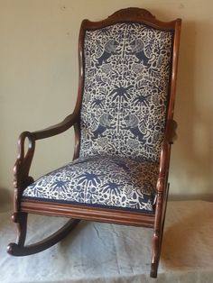 """Our client had this heirloom rocking chair reupholstered and restored (in Robert Allen).  It's for her """"coming soon"""" little boy whose name translates to """"lion"""". Too perfect!  www.denicolasbr.com"""
