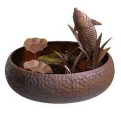 Grasslands Road Metal Fish Fountain, 17-Inch, Brown. Brown, Saddle Brown, Sienna, Peru, Chocolate, Dark Goldenrod, Sandy Brown, Burly Wood, Dark Khaki, Rosy Brown, black color. Let the burbling sounds of this jumping coy fish fountain bring serenity to indoor and outdoor gardens of every kind. A beautiful home, office, or gazebo accessory for all seasons not be exposed to winter climate below 33 degrees Fahrenheit. Check out other charming items from Grasslands Road collection to...