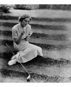 model Elizabeth Blair wears a smart, pressed white golfing suit from 1934 linen dress, leather golf glove, and lace-up golf shoes that would inform the style of a ladies' oxford © Toni Frissell