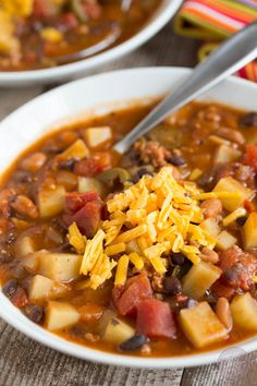 This slow cooker chorizo, potato, and two-bean chili is spicy but fits the bill when you want to warm up on a cold night or craving that fire alarm chili!