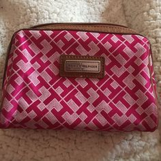 Tommy Hilfiger small pouch Pink and brown Tommy Hilfiger small pouch/ make up case! Never really used still in store quality condition, willing to work on pricing!! Tommy Hilfiger Bags Cosmetic Bags & Cases