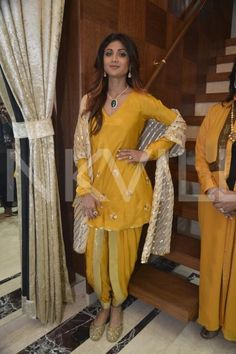 Actress Shilpa Shetty Kundra was recently spotted at an event in Mumbai. Defying the age from every corner, the actress looked gorgeous in a mustard yellow dhoti style salwar kameez by designer… Dress Indian Style, Indian Dresses, Indian Outfits, Ethnic Outfits, Western Dresses, Western Outfits, Indian Attire, Indian Wear, Dhoti Salwar Suits