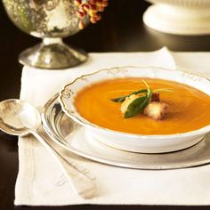 Update the classic butternut squash soup with shallots and fresh herbs like sage and thyme.
