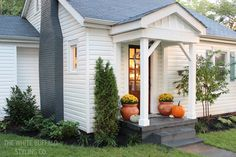 Cottage Exterior Redo - barn shutters (spray-painted in Rustoleum's Seaside!), board and batten over entry