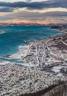 Tromso in Snow, Norway ….Stay cheap and comfortable on your stopover in Oslo: www.airbnb.com/rooms/1036219?guests=2&s=ja99 and https://www.airbnb.com/rooms/7806138