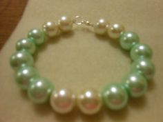 Bracelet Green pastel with cream beads for accent 7 by JewelrybyKN