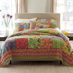 100% cotton quilt. Our hand-quilted patchwork quilt spans the botanical spectrum from exuberant reds and yellows to greens and blues.