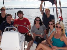 """BIRTHDAY SAIL - Drew O'Neal's family threw him a wonderful birthday party while sailing all afternoon on the York River. His daughters organized an elegant lunch, which they spread out in the sailboat salon below deck, followed by gifts and a cake. """"Happy Birthday"""" never sounded better than out on the water."""