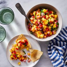 Scoop this easy and healthy peach-mango salsa up with tortilla chips, serve it with grilled chicken, salmon or pork chops, or use it as a taco topper. It's a versatile and vibrant addition to all sorts of meals. Chicken Appetizers, Healthy Appetizers, Appetizer Recipes, Party Recipes, Healthy Recipes For Diabetics, Diabetic Foods, Diabetic Recipes, Healthy Foods, Mango Salsa Recipes