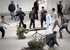 """Int'l Reporters Confirm Hamas' Use of Civilians as Human Shields - """"Right in the back parking lot of Al Shifa Hospital, a rocket was launched, two o'clock in the morning."""" -- HS, Finnish reporter (PHOTO: Young boys act as human shields for this Hamas terrorists launching missiles to Israel.