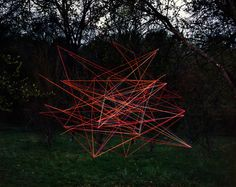 Guests create a glow stick sculpture with buckets of glow sticks