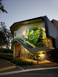 Wow! Love this inside.outside vertical garden!   #Gardens #modernarchitecture