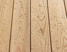 Not sure when to re-seal your deck? Drizzle water on the boards. If the water beads up, the wood is still protected; if it's absorbed into the wood, it's time to seal again.