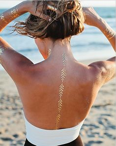 Our latest obsession, from Bloomingdale's , www. Bloomingdales.com Lulu DK Love Story Temporary Jewelry Tattoos, white tattoes down length of spine back, pretty on tan skin Pack of 2 Our latest obsession March 2015