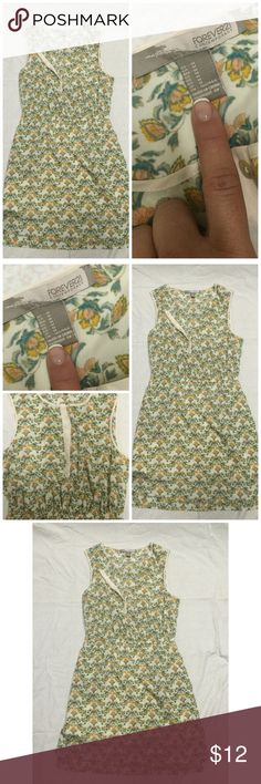Floral dress Lovely floral dress. Light weight, but completely lined. Hardly worn. Size medium. Dresses