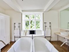 Love the double bath!  Also like the floor and general feel.  BarnsleyHouse_Room1