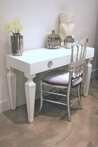 White desk / dressing table / vanity unity with silver metallic & lilac velvet chair, owl ornament and silver glass vase.