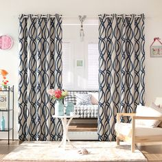These stunning curtains feature a wavy geometric pattern on a variety of color options. Crafted of 100 percent polyester, this set is conveniently machine washable.