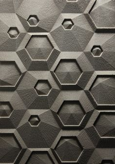 Part of a series of work proposing new architectural surfaces. This is a grid of nested hexagons with linework radiating from the center of each module. It was designed, drawn and fabricated digitally. The material is mdf milled with a CNC router. How fascinating this is--so simple and yet so complex.