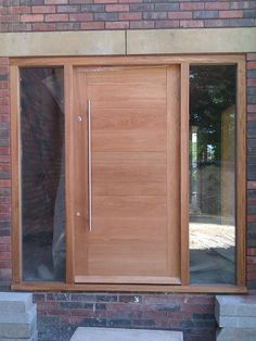 Modern solid oak front door, custom designed for new build. Made by The Bespoke Door Company.