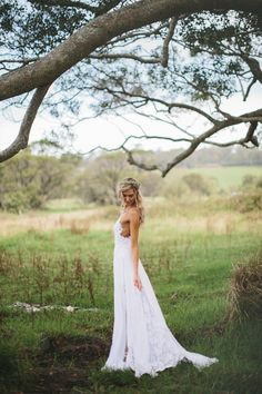 Stunning low back white lace wedding dress.  Perfect for a Central Park Wedding!