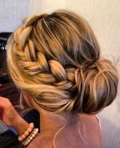I think this is gorgeous. Boho-chic. I love the low bun look and the braid just dresses it up a little bit.